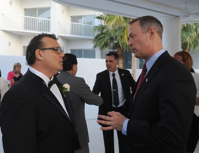 Chris Miller, Clark County Democratic Party chairman, left, talks to Maryland Gov. Martin O'Malley at the Nevada Democratic Party's Jefferson-Jackson dinner at the Tropicana hotel-casino in Las Ve ...