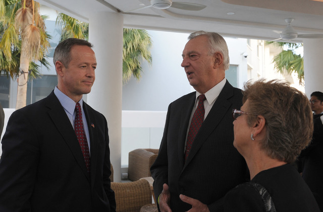 Maryland Gov. Martin O'Malley, left, meets with Bill Hurd and his wife Elaine at the Nevada Democratic Party's Jefferson-Jackson dinner at the Tropicana hotel-casino in Las Vegas, Friday, May 2, 2 ...