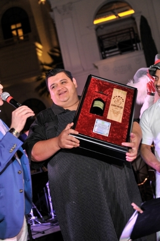 Nectaly Mendoza, owner of Herbs & Rye, holds the Chartreuse Award presented to him by Southern Wine & Spirits of Nevada's Executive Director of Mixology & Spirits Education Francesco Lafranconi  ...