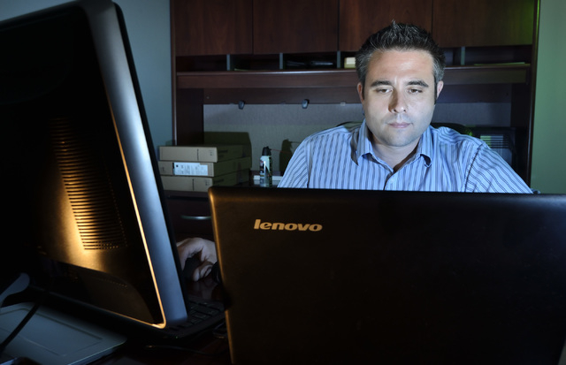 Tim Trevino, chief technology officer for Dot Vegas Inc., works at his office at 6325 S. Jones Blvd. on Wednesday, May 28, 2014. (Bill Hughes/Las Vegas Review-Journal)