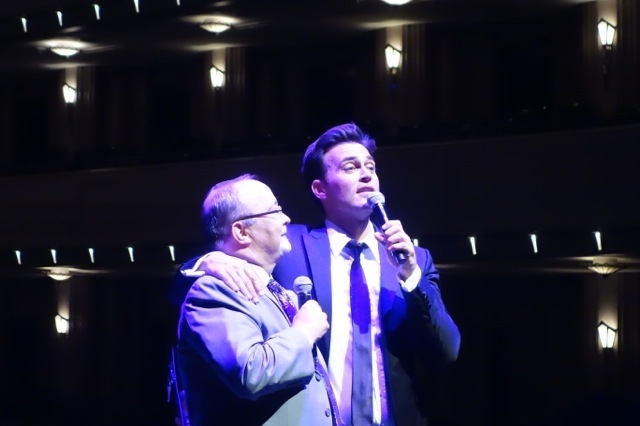Cheyenne Jackson on stage with Smith Center CEO Myron Martin at Reynolds Hall Wednesday night. (Norm Clarke/Las Vegas Review-Journal)