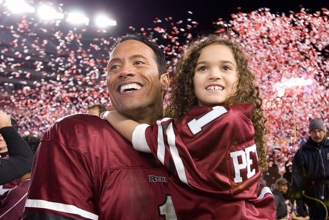"""Dwyane Johnson (left) and Madison Pettis in """"The Game Plan."""" (Walt Disney Pictures)"""