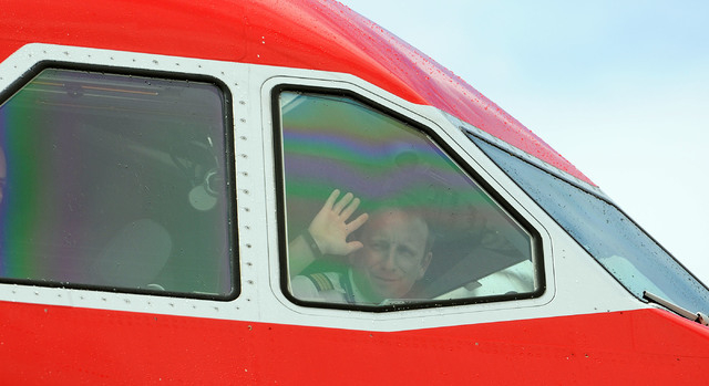 First Officer Phillipp Spitteler Waves To The Media As Inaugural Edelwiess Air Flight From Zurich
