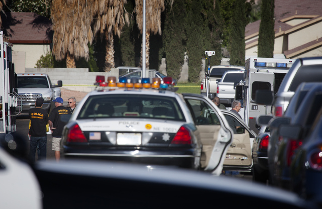 Las Vegas police  at a barricade situation at 6100 block of Evensail Drive, near Lake Mead Boulevard and Mt. Hood Street on Tuesday, May 6, 2014. Las Vegas police responded to the home just after  ...