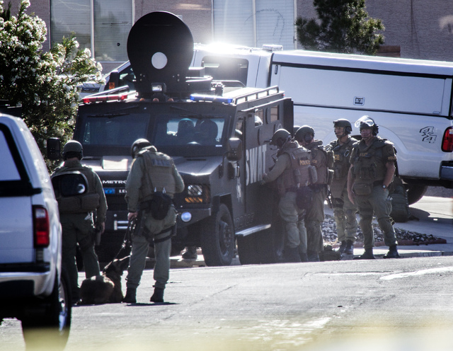 Las Vegas SWAT members  at the barricade situation at 6100 block of Evensail Drive, near Lake Mead Boulevard and Mt. Hood Street on Tuesday, May 6, 2014. Las Vegas police responded to the home jus ...