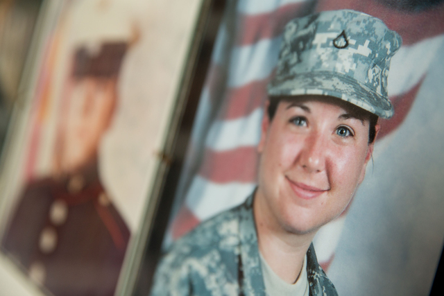 A photo of Jasmine Carreon (cq), granddaughter of Phyllis Hebert, is one of 27 portraits of friends and family who have served in the armed services displayed inside Herbert's home. (Samantha Clem ...