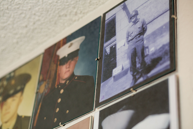 Phyllis Hebert's father, Lawrence Chapin, top right, is shown in a photo taken while he served during World War II on Friday, May 23, 2014. Hebert dedicated a wall in her home to photos, honoring  ...