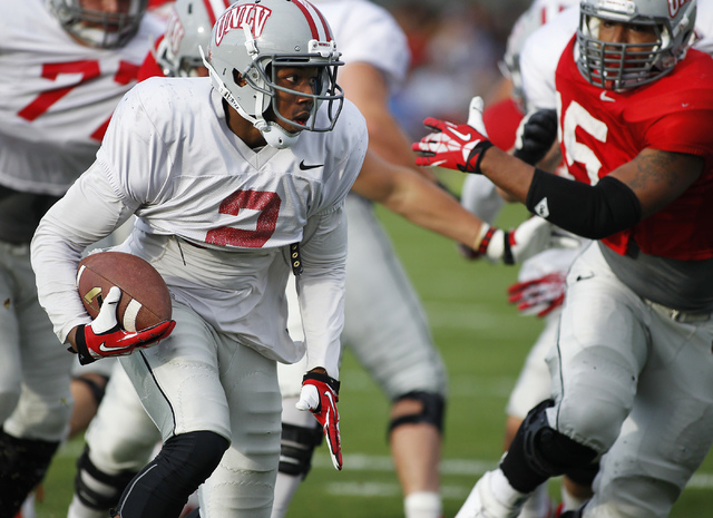 Running back Adonis Smith (2) carries the ball for the Grey team during UNLV's annual spring football game at Peter Johann Memorial Field in Las Vegas on April 11, 2014. Smith scored two touchdown ...