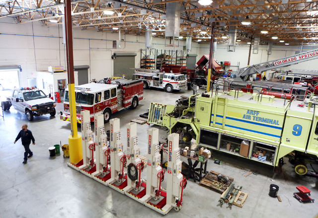 Firefighting equipment is stored in a large mechanic garage at Firetrucks Unlimited Friday, May 30, 2014, in Henderson. Firetrucks Unlimited, a family-owned business that opened in 2007, repairs,  ...