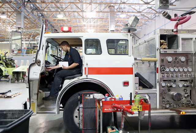 Andrew Molitor works on a fire engine that is slated to be delivered to a fire department in Runge, Texas, at Firetrucks Unlimited Friday, May 30, 2014, in Henderson. Firetrucks Unlimited, a famil ...