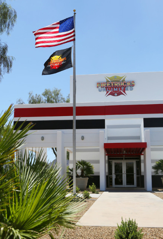 Flags wave in the wind outside Firetrucks Unlimited Friday, May 30, 2014, in Henderson. Firetrucks Unlimited, a family-owned business that opened in 2007, repairs, refurbishes and sells fire truck ...