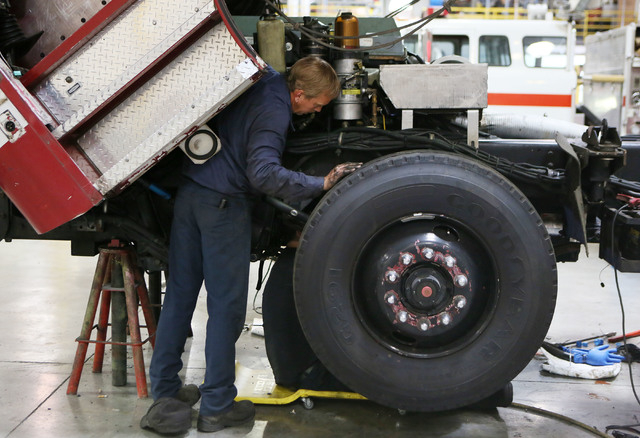 Mike Laqua, works on a fire engine for a fire department in Little Rock, Arkansas, at Firetrucks Unlimited Friday, May 30, 2014, in Henderson. Firetrucks Unlimited, a family-owned business that op ...