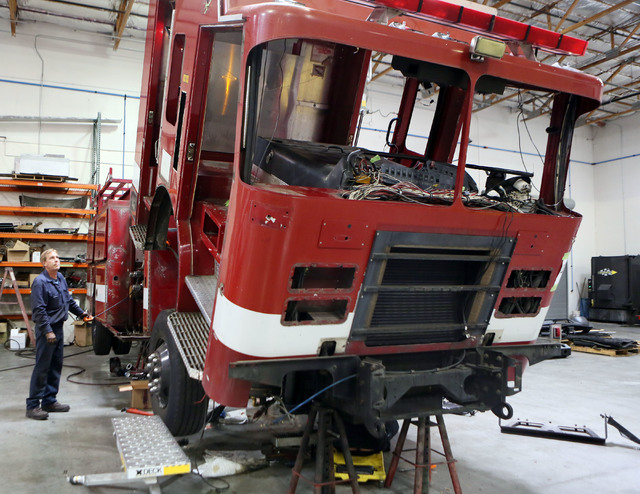 Mike Laqua, works on a fire engine for a fire department in Little Rock, Ark., at Firetrucks Unlimited Friday, May 30, 2014, in Henderson. Firetrucks Unlimited, a family-owned business that opened ...