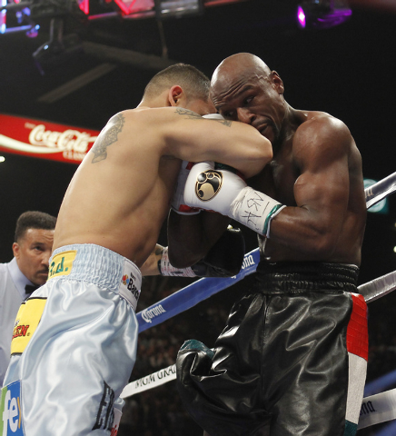 Marcos Maidana puts Floyd Mayweather Jr. on the ropes during their welterweight title bout at the MGM Grand in Las Vegas Saturday, May 3, 2014. (Jason Bean/Las Vegas Review-Journal)