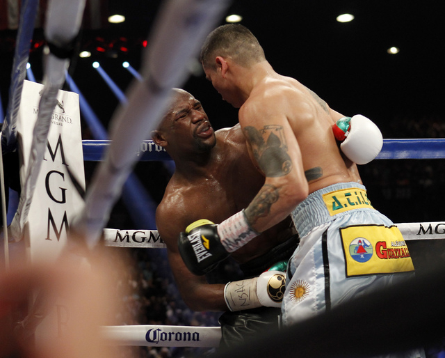 Marcos Maidana hits Floyd Mayweather Jr. below the belt during their welterweight title bout at the MGM Grand in Las Vegas Saturday, May 3, 2014. (Jason Bean/Las Vegas Review-Journal)