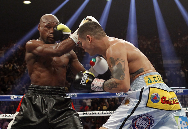 Marcos Maidana hits Floyd Mayweather Jr. in the fifth round of their welterweight title bout at the MGM Grand in Las Vegas Saturday, May 3, 2014. (Jason Bean/Las Vegas Review-Journal)
