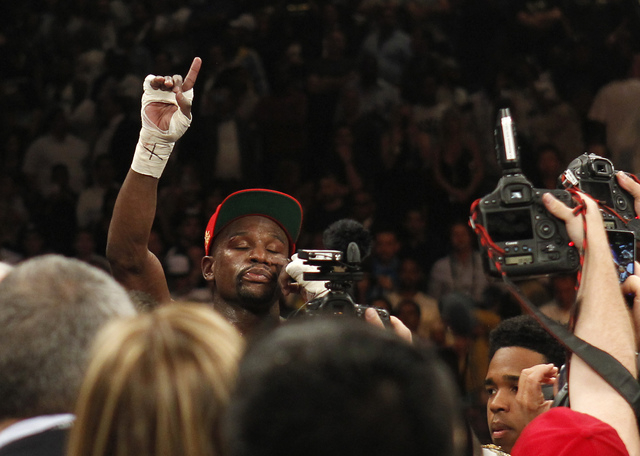 Floyd Mayweather Jr. celebrates after defeating Marcos Maidana in their welterweight title bout at the MGM Grand in Las Vegas Saturday, May 3, 2014. (Jason Bean/Las Vegas Review-Journal)