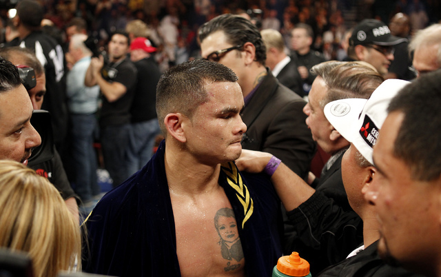 Marcos Maidana reacts after losing Floyd Mayweather Jr. in their welterweight title bout at the MGM Grand in Las Vegas Saturday, May 3, 2014. (Jason Bean/Las Vegas Review-Journal)