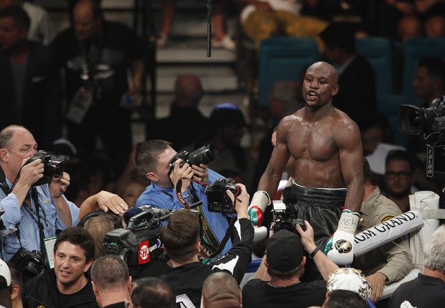 Floyd Mayweather Jr. celebrates after defeating Marcos Maidana in their welterweight title bout at the MGM Grand in Las Vegas Saturday, May 3, 2014. (John Locher/Las Vegas Review-Journal)