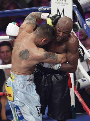 Marcos Maidana hits Floyd Mayweather Jr. during their welterweight title bout at the MGM Grand in Las Vegas Saturday, May 3, 2014. (John Locher/Las Vegas Review-Journal)