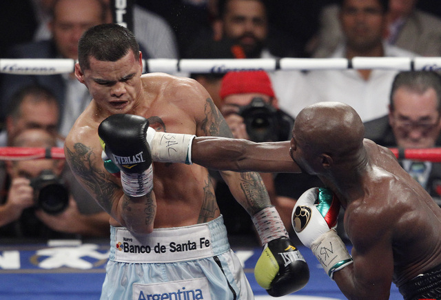 Floyd Mayweather Jr. hits Marcos Maidana during their welterweight title bout at the MGM Grand in Las Vegas Saturday, May 3, 2014. (John Locher/Las Vegas Review-Journal)