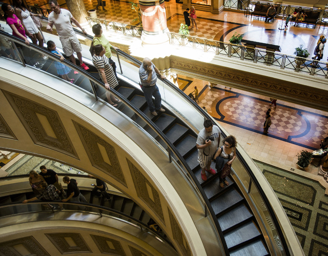 People ride an escalator at The Forum Shops at Caesars on Monday, May 12, 2014.  A mix of new retail stores and restaurant will be opening soon in the 22-year-old mall located in Caesars. The Foru ...