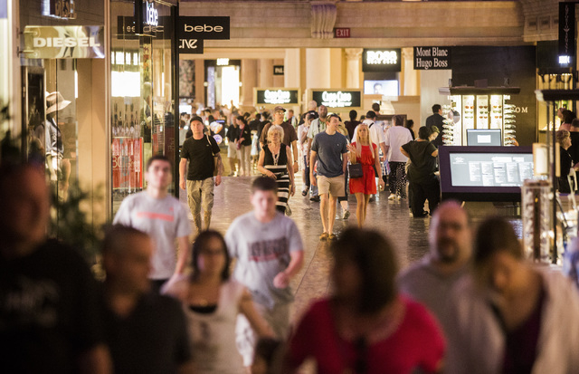 People walk The Forum Shops at Caesars on Monday, May 12, 2014.  A mix of new retail stores and restaurant will be opening soon in the 22-year-old mall located in Caesars. The Forum Shops receives ...