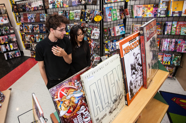 David Keniston and Jenny Wu browse through comics at Alternate Reality Comics, 4110 S. Maryland Parkway, in Las Vegas on Wednesday, April 23, 2014. The store is slated to participate in Free Comic ...