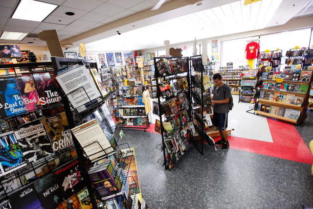Taylor Chance browses through comics at Alternate Reality Comics, 4110 S. Maryland Parkway, in Las Vegas on Wednesday, April 23, 2014. The store is slated to participate in Free Comic Book Day on  ...