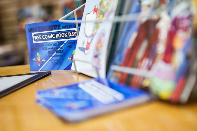 A card advertising Free Comic Book Day is seen on display at Alternate Reality Comics, 4110 S. Maryland Parkway, in Las Vegas on Wednesday, April 23, 2014. Free Comic Book Day is slated to occur o ...