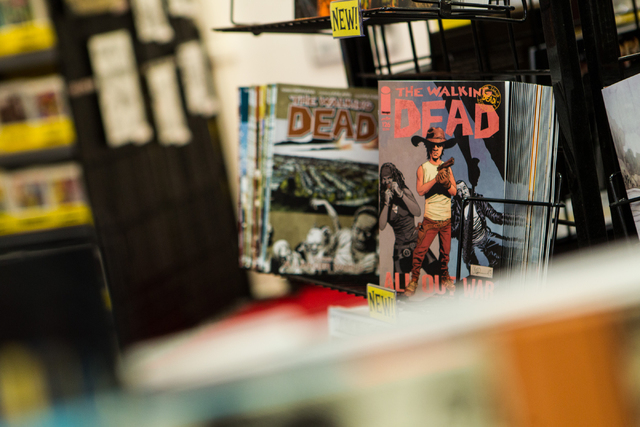 The Walking Dead comics are seen on display at Alternate Reality Comics, 4110 S. Maryland Parkway, in Las Vegas on Wednesday, April 23, 2014. The store is slated to participate in Free Comic Book  ...