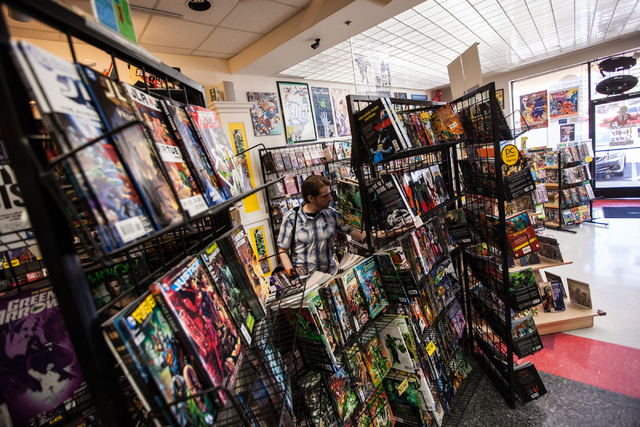 A man browses through comics at Alternate Reality Comics, 4110 S. Maryland Parkway, in Las Vegas on Wednesday, April 23, 2014. The store is slated to participate in Free Comic Book Day on May 3. ( ...