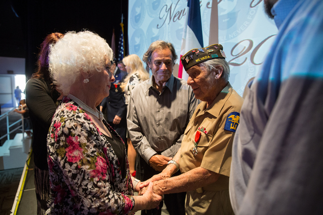 Marilyn Leonard, left, talks with Gaetano R. Benza, 89, after Leonard's husband, Davis B. Leonard, and Benza were awarded the Legion of Honor for their service in World War II at the Silverton on  ...