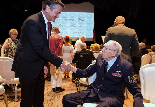 Eric Auger, the honorary consul of France in Southern Nevada, left, introduces himself to Davis B. Leonard, 91, at the Silverton on Friday, May 30, 2014. Leonard was awarded the Legion of Honor fo ...