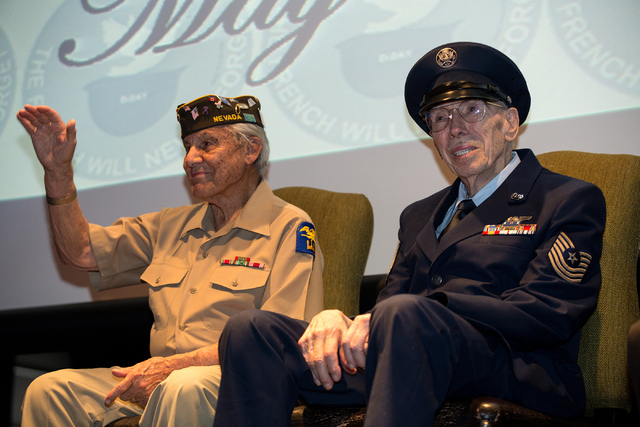 Gaetano R. Benza, 89, left, and Davis B. Leonard, 91, attend a ceremony where they were awarded the Legion of Honor for their service in World War II at the Silverton on Friday, May 30, 2014. (Sam ...