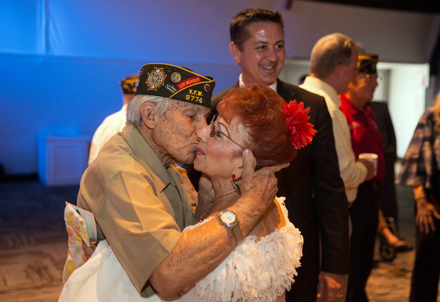 Gaetano R. Benza, 89, left, greets friend Millie Caruso before the start of a ceremony where Benza was awarded the Legion of Honor for his service in World War II at the Silverton on Friday, May 3 ...