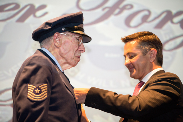 Davis B. Leonard, 91, is pinned with the Legion of Honor by Eric Auger, the honorary consul of France in Southern Nevada, for his service in World War II at the Silverton on Friday, May 30, 2014.  ...
