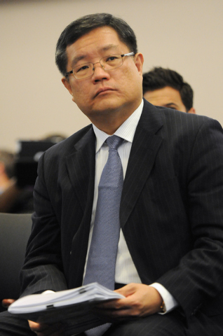 Kong Han Tan, president and CEO of Genting Berhad listens during a hearing at the Nevada Gaming Commission at the Sawyer Building in Las Vegas Thursday, May 22, 2014. Genting Group's proposal to b ...