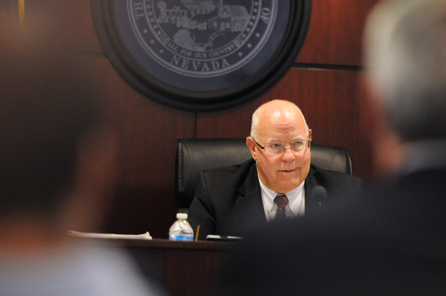 Nevada Gaming Chairman Peter Bernhard listens to a presentation by officials with Genting Group during a hearing at the Sawyer Building in Las Vegas Thursday, May 22, 2014. Genting Group's proposa ...