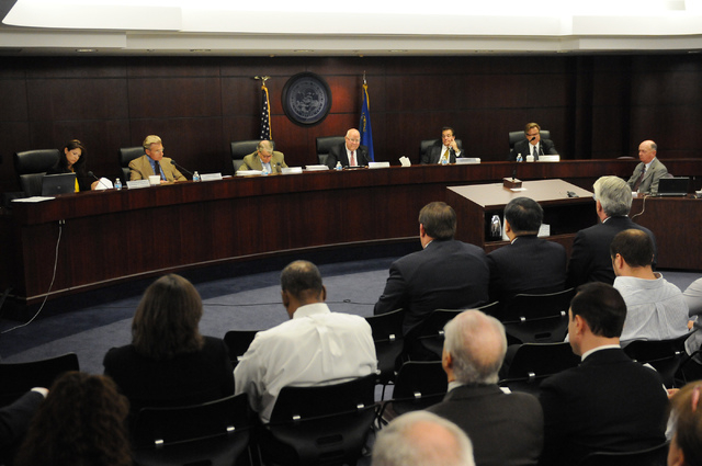 Nevada Gaming commissioners participate during a hearing at the Sawyer Building in Las Vegas Thursday, May 22, 2014. Genting Group's proposal to build Resorts World Las Vegas was approved during t ...