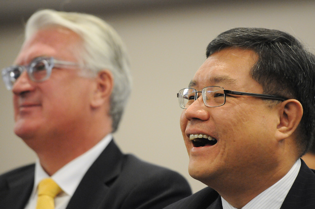 Kong Han Tan, right, president and CEO of Genting Berhad and his attorney Mark Clayton, listen during a hearing at the Nevada Gaming Commission at the Sawyer Building in Las Vegas Thursday, May 22 ...