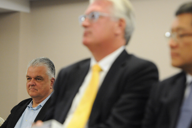 Clark County Commissioner Steve Sisolak, left, listens during a hearing at the Nevada Gaming Commission at the Sawyer Building in Las Vegas Thursday, May 22, 2014. (Erik Verduzco/Las Vegas Review- ...
