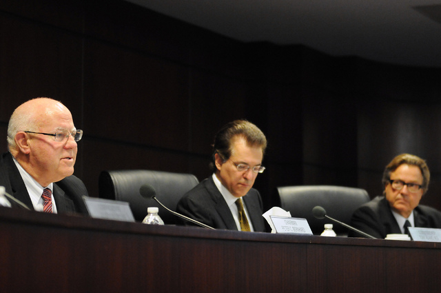 Nevada Gaming Commissioners Peter Bernhard, from left, Tony Alamo and John Moran Jr., listen to a presentation by Genting Group officials during a hearing at the Sawyer Building in Las Vegas Thurs ...