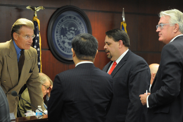 Nevada Gaming Commissioner Randolph Townsend, from left, speaks with Kong Han Tan, president and CEO of Genting Berhad, Christian Goode, CFO/Sr. VP Development Genting Americas and their attorney  ...