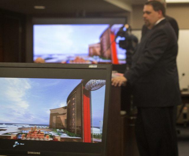 Christian Goode, right, CFO/Sr. VP Development Genting Americas speaks in front of the Nevada Gaming Control Board  during a suitability hearing at  Sawyer Building on Wednesday, May 7, 2014. Gent ...