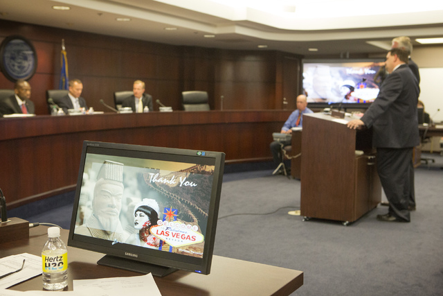 Genting Berhad  executive Christian Goode, right,  speaks  in front of the Nevada Gaming Control Board  during a suitability hearing at  Sawyer Building on Wednesday, May 7, 2014. Genting Group is ...