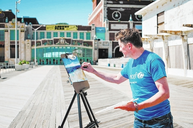 "British artist Glyn Macey, at work in Asbury Park, N.J., earlier this month, brings his cross-country USA 4 UNICEF tour to Las Vegas Friday afternoon, where he'll paint the ""Welcome to Fabulous La ..."