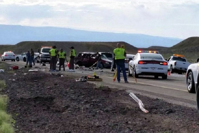 Authorities say four people have died and four more have been injured in a van rollover crash in Utah on Interstate 70, about 30 miles west of the Colorado border. (David Jones/ksl.com)