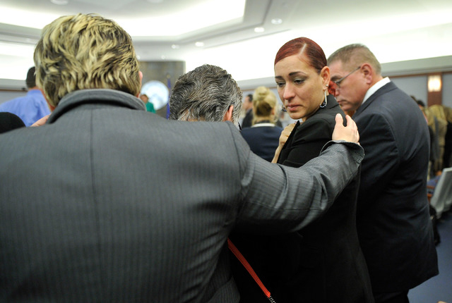 Celeste Flores Narvaez, sister of Deborah Flores Narvaez, second right, is comforted after a guilty verdict was read during the murder trial at the Regional Justice Center on Thursday, May 22, 201 ...