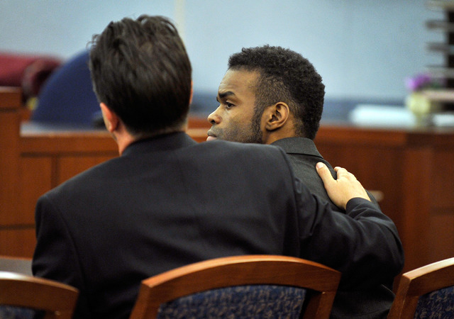 """Jason """"Blu"""" Griffith is comforted by his attorney Jeff Banks after a guilty verdict was read during his murder trial at the Regional Justice Center on Thursday, May 22, 2014. Griffith wa ..."""